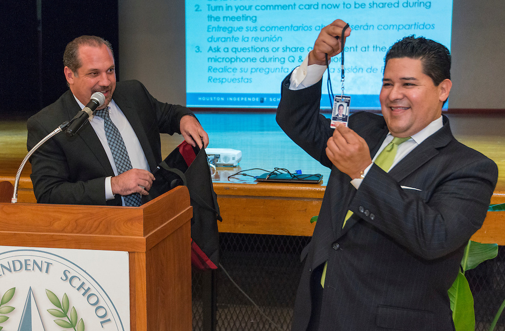 Paolo Castagnoli presents Superintendent Richard Carranza with a school ID during a stop of the Listen & Learn tour at Black Middle School, September 20, 2016.