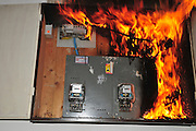 A fire broke out in a household electrical fuse box flames consumed the board. Photographed in Israel