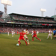 Joe Allen, Liverpool, is challenged by Michele Somma, AS Roma, in action during the Liverpool Vs AS Roma friendly pre season football match at Fenway Park, Boston. USA. 23rd July 2014. Photo Tim Clayton