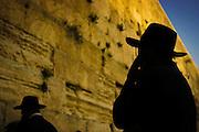 Jews gather at the Western Wall  (Kotel ha-Ma'aravi) to give Prayer just before sundown.