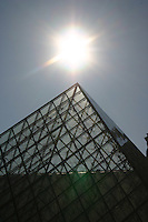 Sunlight over the glass pyramid at the Louvre Paris<br />