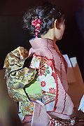 young adult woman in the traditional formal furisode style kimono dress for unmarried women Japan