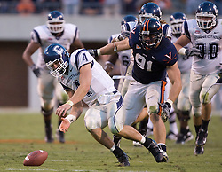 Connecticut quarterback Tyler Lorenzen (4) dives to scoop up the first of two fumbles late in the fourth quarter.  The Virginia Cavaliers defeated the Connecticut Huskies 17-16 at Scott Stadium in Charlottesville, VA on October 13, 2007