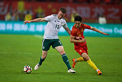 NANNING, CHINA - Thursday, March 22, 2018: Wales' Marley Watkins and China's Wei Shihao during the opening match of the 2018 Gree China Cup International Football Championship between China and Wales at the Guangxi Sports Centre. (Pic by David Rawcliffe/Propaganda)