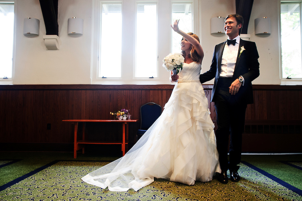 photo by Matt Roth.Saturday, April 14, 2012.Assignment ID: 30124225A..Molly Spencer Palmer and Lee Cowan married each other at St. Albans Parish in Washington D.C. Saturday, April 14, 2012. Molly waves to a ceremony attendee before havin their wedding portraits made...Molly Palmer, 29, and Lee Cowan, 46, were colleagues at NBC News, but it wasn't until The Balloon Boy story coverage in 2009 that their romance sparked.