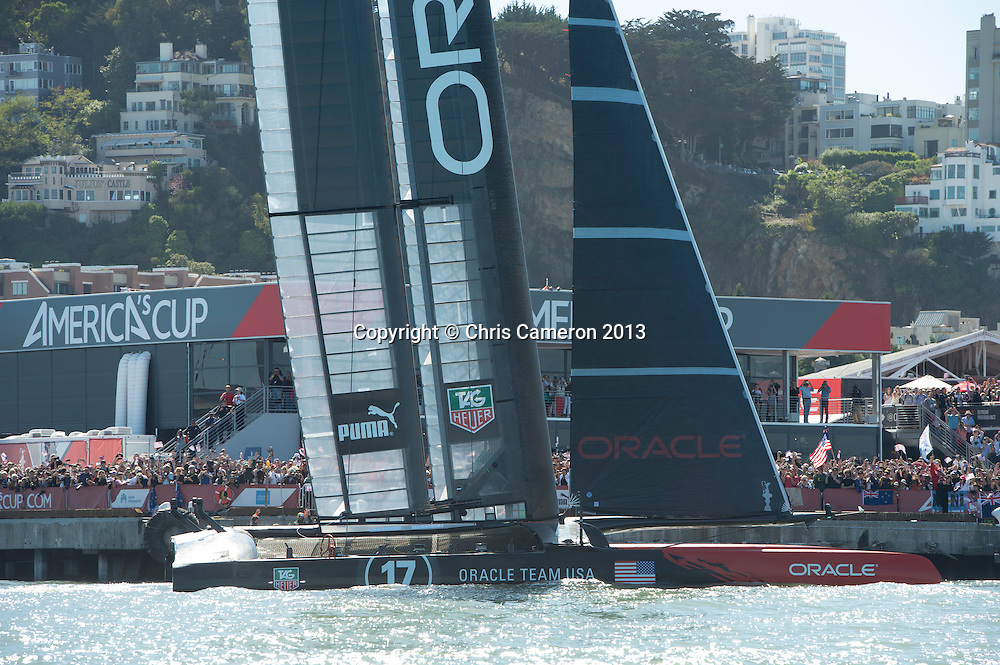 Oracle Team USA pass by the America's Cup Park after winning race 15 on day 12 of America's Cup 34. 22/9/2013