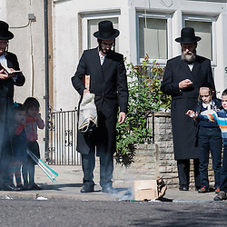 London, UK - 14 April 2014: On the morning before Passover, members of the Jewish Community of Stamford Hill burn all the chametz (leavened products) during the bi'ur ceremony