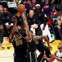 30 March 2018: Los Angeles Lakers forward Julius Randle (30) and Los Angeles Lakers forward Brandon Ingram (14) jump for the rebound during the Milwaukee Bucks 124-122 victory over the LA Lakers, at the Staples Center, Los Angeles, California, USA.