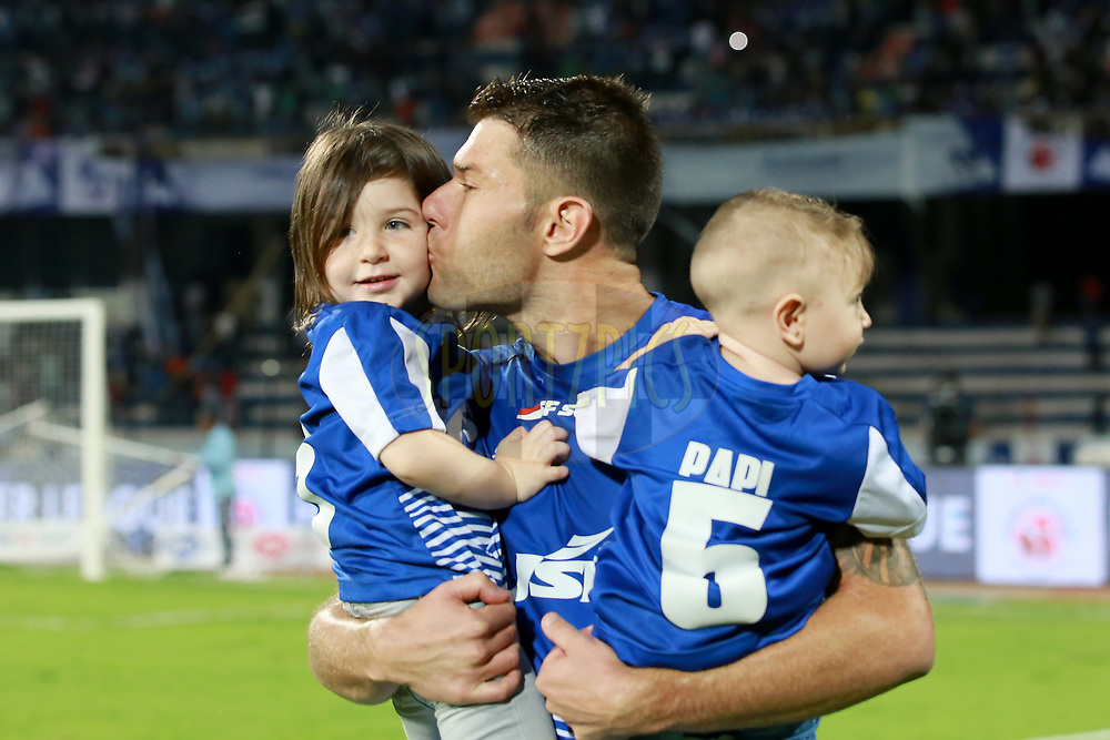 John Johnson of Bengaluru FC  with his kids after winning the first semi final 2nd leg of the Hero Indian Super League between Bengaluru FC and FC Pune City  held at the Sree Kanteerava Stadium, Bengaluru, India on the 11th March 2018 <br /> <br /> Photo by: Faheem Hussain / ISL / SPORTZPICS