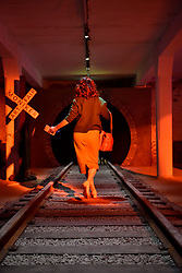 © Licensed to London News Pictures. 06/10/2017. London, UK.  A visitor walks down a set of railway tracks by Bill Daniels at entrance to the Moniker Art Fair, the world's biggest urban art fair, taking place at the Old Truman Brewery in East London from 5 to 8 October 2017.  The fair brings together the world's most influential new-contemporary and urban art galleries to show international artworks to Londoners. Photo credit : Stephen Chung/LNP