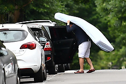 © Licensed to London News Pictures. 24/06/2017. London, UK. A man carries a mattress to his car as Residents are evacuated from the Bray block on the Chalcots Estate in Camden after it failed a fire inspection because of combustable cladding. More than 700 flats in tower blocks on an estate in the Swiss Cottage area of north-west London are being evacuated because of fire safety concerns. Photo credit: Ben Cawthra/LNP