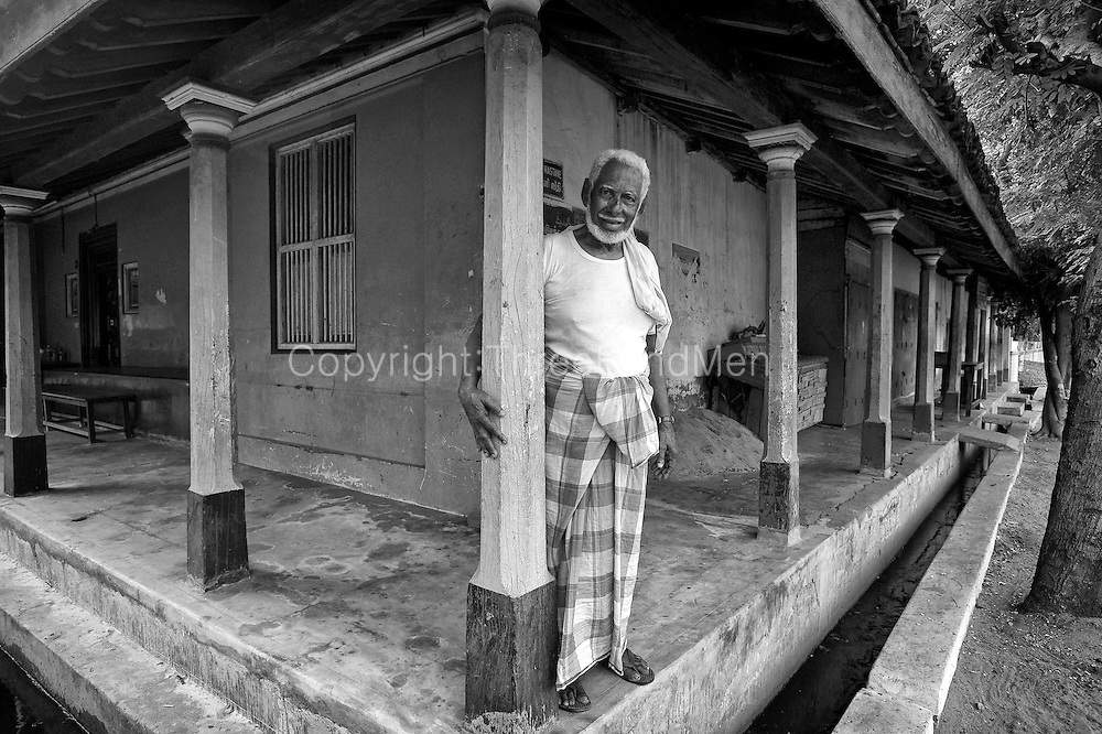 Mr. Abdul Cader. House on corner of two streets in old quarter of Karaikal. Puducherry State.<br /> South India.