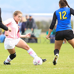 Helena High's Grace Lawlor threads her way through the Big Sky's defenders during Saturday's match at Siebel Fields.