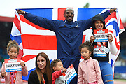 Mo Farah of Great Britain celebrates with his family after winning his last track race in the UK during the Muller Grand Prix Birmingham 2017 at the Alexander Stadium, Birmingham, United Kingdom on 20 August 2017. Photo by Martin Cole.
