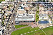 Nederland, Noord-Holland, Amsterdam, 09-04-2014; Van Baerlestraat met trambaan en klein stukje Concertgebouw (linksonder). Het gras van het Museumplein met Stedelijk Museum en het Van Goghmuseum. Woonwijk Oud-Zuid.<br /> Museumplein and The Stedelijk Museum Amsterdam next to the Van Goghmuseum.<br /> luchtfoto (toeslag op standard tarieven);<br /> aerial photo (additional fee required);<br /> copyright foto/photo Siebe Swart
