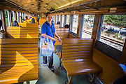 07 JANUARY 2013 - KANCHANABURI, THAILAND:   A food vendor walks through a third class train car on the train between Bangkok (Thonburi station) and Kanchanaburi. Thailand has a very advanced rail system and trains reach all parts of the country.    PHOTO BY JACK KURTZ