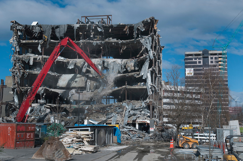 Earthquake demolition quickly progresses on 151 Kilmore Street, part of which was the pre earthquake home of TV3, rear right is the Price Waterhouse Coopers building also being demolished, Christchurch, New Zealand, Monday, May 28, 2012. Credit :  SNPA / David Alexander