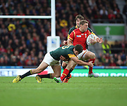 Wales Rhys Priestland getting tackled during the Rugby World Cup Quarter Final match between South Africa and Wales at Twickenham, Richmond, United Kingdom on 17 October 2015. Photo by Matthew Redman.