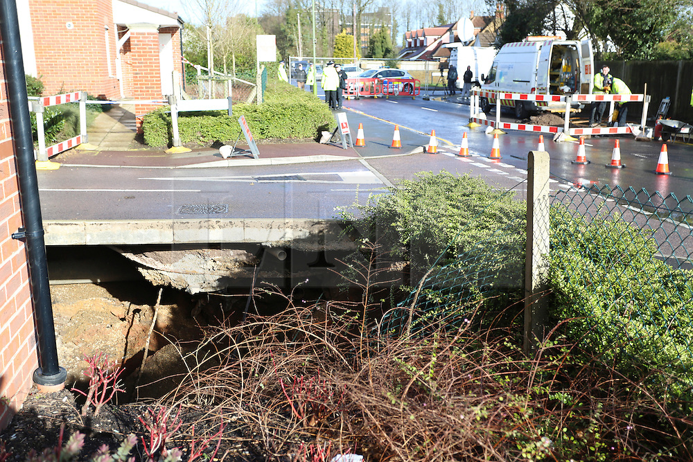 © London News Pictures. 15/02/2014. Hemel Hempstead, UK.  A giant sinkhole (pictured) measuring 35ft wide by 20ft deep has opened up next to a house in Hemel Hempstead, Hertfordshire.   Photo credit: Ben Cawthra/LNP