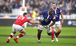 France's Demba Bamba (right) gets away from Wales' Gareth Davies during the Guinness Six Nations match at the Stade De France, Paris.