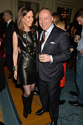 ANDREW ROBERTS and his wife SUSAN GILCHRIST at a party to celebrate the publication of The Romanovs 1613-1918 by Simon Sebag-Montefiore held at The Mandarin Oriental, 66 Knightsbridge, London on 2nd February 2016.