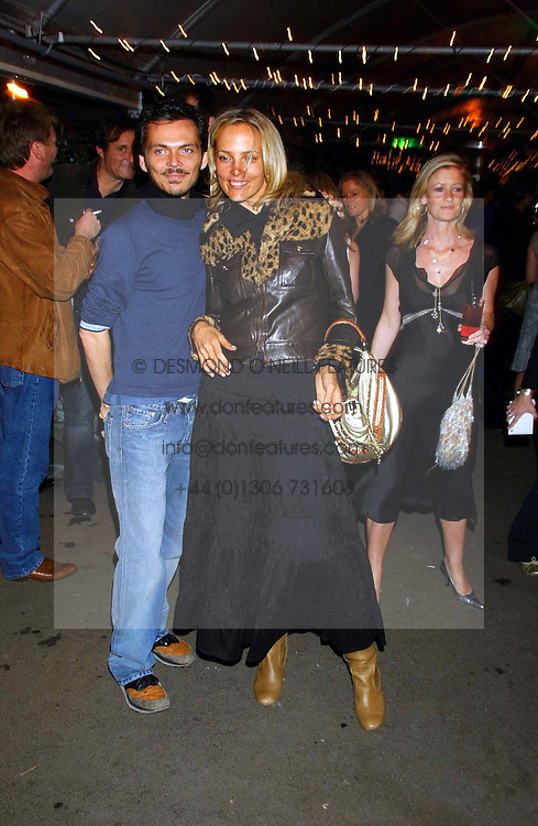 BAY GARNET and MATTHEW WILLIAMSON at an exclusive evening featuring the greatest talents in fashion today in aid of the African children who have been affected bt the AIDS epidemic held at the Chelsea Gardener, Sydney Street, London on 20th September 2004<br /><br />NON EXCLUSIVE - WORLD RIGHTS