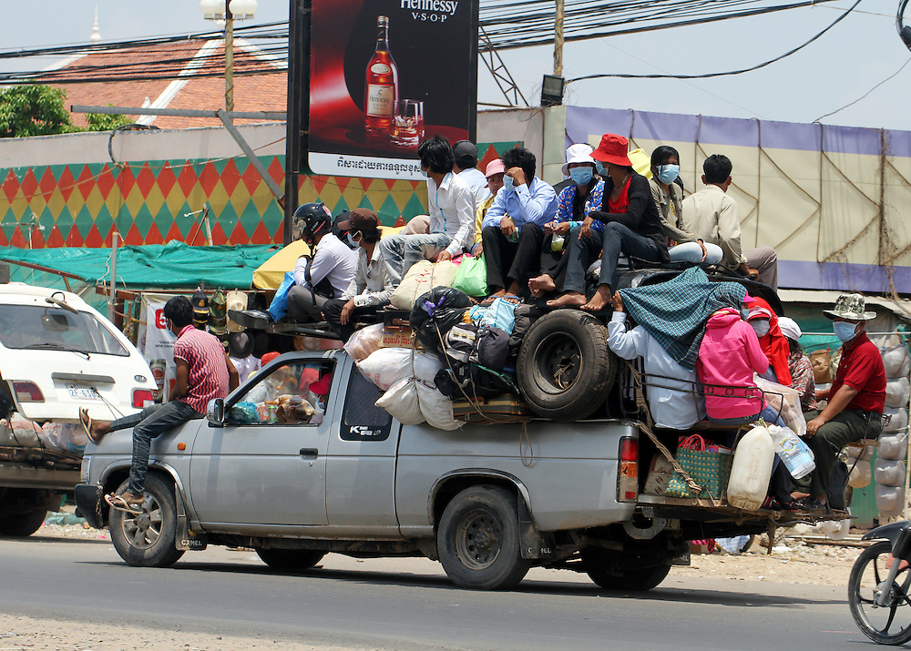 A variety of  transport is used which is often overloaded and in poor repair, Phnom Penh, Cambodia, Wednesday, April 11, 2012. Credit SNPA / Peter Graney.