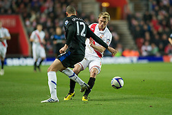 SOUTHAMPTON, ENGLAND - Saturday, January 29, 2011: Manchester United's Chris Smalling and Southampton's Lee Barnard during the FA Cup 4th Round match at St. Mary's Stadium. (Photo by Gareth Davies/Propaganda)