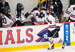 March 13 2016: Robert Morris Colonials forward Zac Lynch (27) celebrates with teammates on the bench after scoring a goal during the second period in game three of the Atlantic Hockey quarterfinals series between the Bentley Falcons and the Robert Morris Colonials at the 84 Lumber Arena in Neville Island, Pennsylvania (Photo by Justin Berl)