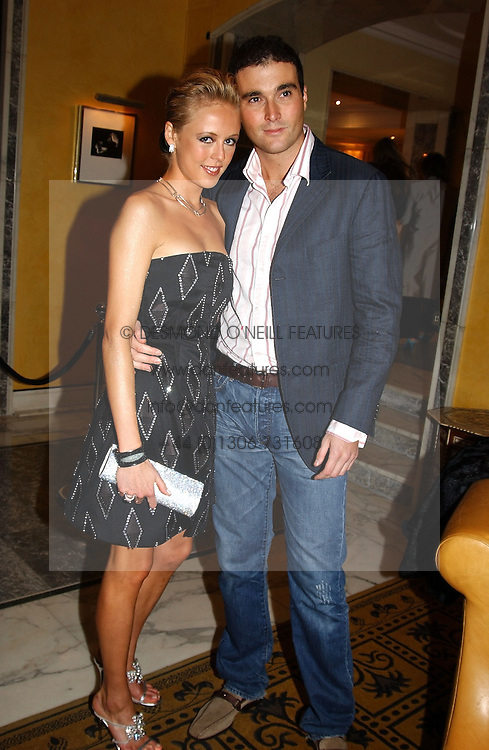LADY ALEXANDRA SPENCER-CHURCHILL and MR DAVID PEACOCK at a party to celebrate the launch of Michelle Watches held at the Blue Bar, The Berkeley Hotel, London on 7th October 2004.<br /><br />NON EXCLUSIVE - WORLD RIGHTS
