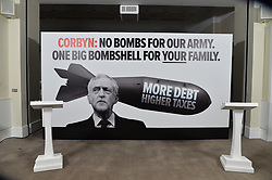 "© Licensed to London News Pictures. 03/05/2017. London, UK. Chancellor of the Exchequer PHILLIP HAMMOND and DAVID DAVIES Secretary of State for Exiting the European Union speak at a General Election Campaign event featuring a poster of Labour party leader JEREMY CORBYN with the slogan ""More debt, higher tax."" Photo credit: Ray Tang/LNP"