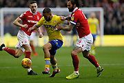 Leeds United midfielder Kemar Roofe (7) shields the ball from Nottingham Forest defender Danny Fox (4)  during the EFL Sky Bet Championship match between Nottingham Forest and Leeds United at the City Ground, Nottingham, England on 1 January 2019.