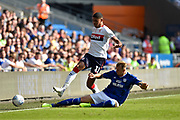Ashley Fletcher (11) of Middlesbrough is tackled by Aden Flint (5) of Cardiff City during the EFL Sky Bet Championship match between Cardiff City and Middlesbrough at the Cardiff City Stadium, Cardiff, Wales on 21 September 2019.