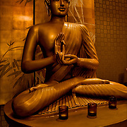 Chinese seated Buddha in Asian restaurant entrance.