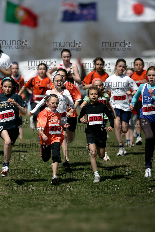 (Kingston, Canada---11 April 2010) Logan Medeiros (#302) of Elginburg PS runs in the Elementary Girls race at the 17th World University Cross Country Championships (FISU) held on the Fort Henry Hill course in Kingston, Ontario, Canada. .Geoff Robins/ Mundo Sport Images..This photograph is Copyright Geoff Robins / Mundo Sport Images, 2010. For information, go to www.mundosportimages.com or contact info@mundosportimages.com.