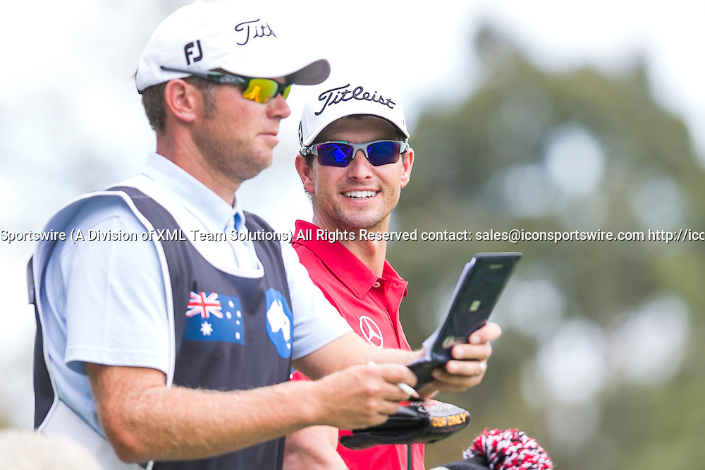November 22, 2014: Adam Scott and his new caddy David Clark during the third round of the Australian Golf Masters at Metropolitan Golf Club, Melbourne Victoria Australia