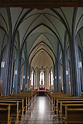 The interior of Landakotskirkja, also known as Dómkirkja Krists Konungs, or Cathedral of Christ the King, in Reykjavik, Iceland. Designed by Guðjón Samúelsson and completed in 1929, it is the cathedral of the Catholic Church of Iceland.