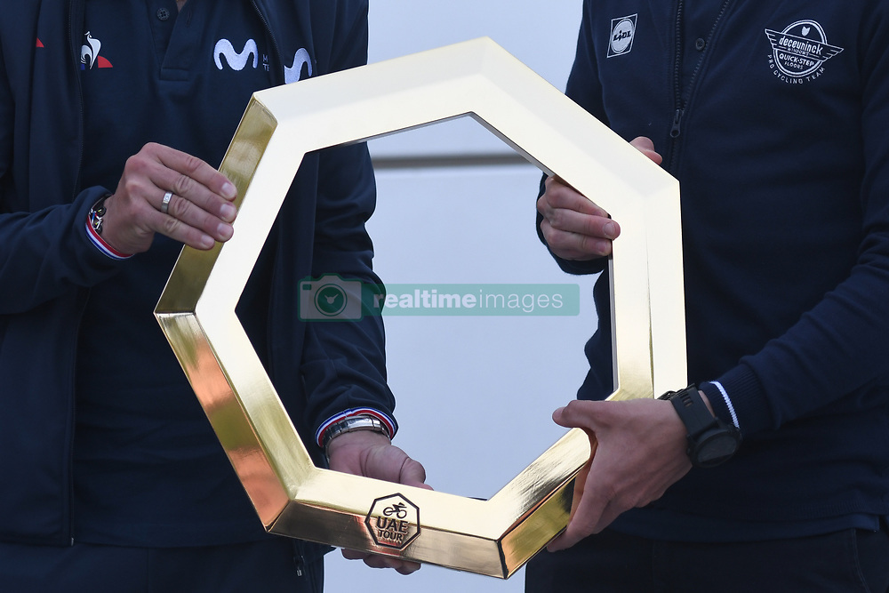 February 23, 2019 - Abu Dhabi, United Arab Emirates - UAE Tour Trophy hold by Alejandro Valverde (Left) of Spain and Movistar Team and Elia Viviani (Right) of Italy and Team Deceuninck-QuickStep, at Top Riders Photo session at the entrance to the Louvre Abu Dhabi museum..On Saturday, February 23, 2019, Abu Dhabi, United Arab Emirates. (Credit Image: © Artur Widak/NurPhoto via ZUMA Press)