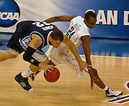 3/21/08---NCAA Division I Men's Basketball Championship---Connecticut vs. San Diego----San Diego's Rob Jones fights for possession against UConn's Craig Austrie in the 2nd half.  KATHY MOORE/TAMPA TRIBUNE.