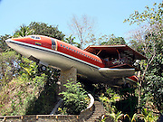 - Costa Verde, Costa Rica - <br /> <br />  Hotel Costa Verde is proud to present its newest lodgings: The fully outfitted, meticulously detailed, two bedroom, Boeing 727 fuselage suite. We have refurbished a vintage 1965 Boeing 727 airframe, which in its prior life shuttled globetrotters on South Africa Air and Avianca Airlines (Colombia). Our phoenix is now ready for its future duty as the most exclusive hotel suite in Costa Rica. We salvaged this airframe, piece by piece, from its San Jose airport resting place. We carefully transported the pieces on five, big-rig trucks to the jungles of Manuel Antonio where they have been resurrected into a unique jumbo hotel suite. Our classic airplane, nestled on the edge of the National Park in our Costa Verde II area, is perched on a 50-foot pedestal. At this height, you will enjoy scenic ocean and jungle views from the hard wood deck built atop the plane's former right wing. The plane's interior is Costa Rican teak paneling from the cockpit to the  tail. Furnishings are hand-carved, teak furniture from Java, Indonesia.  Our 727 home features two air conditioned bedrooms--one with two  queen sized beds and the other with one queen sized bed, each with its  own private bath-a flat screen TV, a kitchenette, dining area foyer; an ocean view terrace; a private entrance up a river rock, spiral staircase; and 360 degrees of surrounding gardens. Enjoy an evening on the terrace while sipping a glass of wine and observing your tree top neighbors: sloths, toucans and monkeys. Our refurbished Boeing 727 home is not the only such dwelling in the world: We were inspired by a Forbes Magazine article about a company offering hurricane-proof living via surplus Boeing 727 airframes! Of course, Photo Shows:  727 Hotel Entrance <br /> (Credit Image: © Vincent Costello/Exclusivepix
