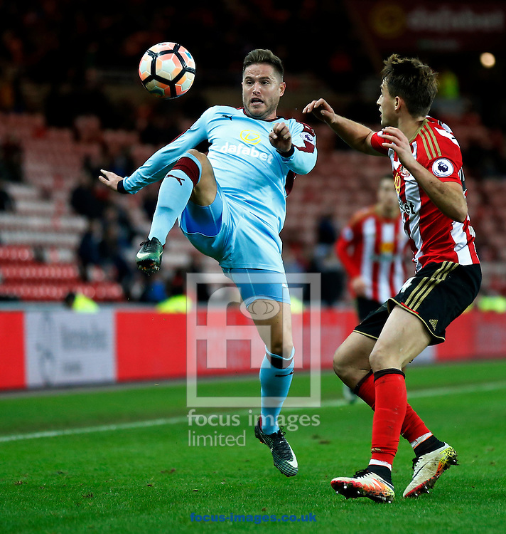 Adnan Januzaj (r) of Sunderland and Michael Kightly of Burnley during the third round of the FA Cup at the Stadium Of Light, Sunderland<br /> Picture by Simon Moore/Focus Images Ltd 07807 671782<br /> 07/01/2017