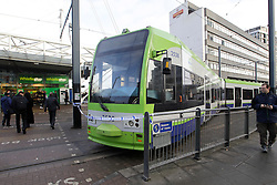© Licensed to London News Pictures. 17/02/2012, London, UK.  People walk by a derailed tram at East Croydon tram stop in Croydon, South London, Friday, Feb. 17, 2012. Photo credit : Sang Tan/LNP