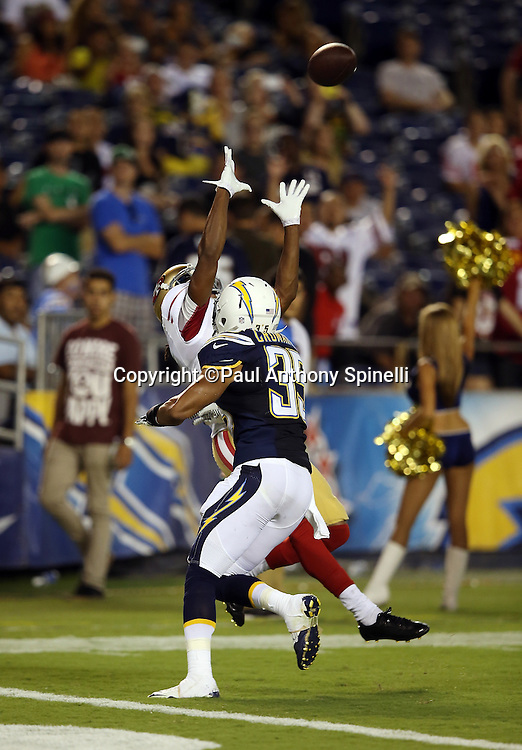 San Francisco 49ers wide receiver Chuck Jacobs (1) leaps and catches a 14 yard touchdown pass good for a 41-6 lead while covered by San Diego Chargers defensive back Marcus Cromartie (35) during the NFL week 4 preseason football game against the San Diego Chargers on Thursday, Aug. 29, 2013 in San Diego. The 49ers won the game 41-6. ©Paul Anthony Spinelli