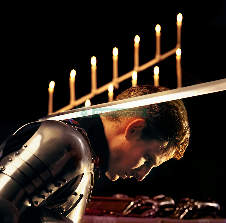 July 21, 2019 - Man In Armor Being Knighted, Side View (Credit Image: © Ron Nickel/Design Pics via ZUMA Wire)