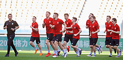 NANNING, CHINA - Tuesday, March 20, 2018: Wales' sports science coach Adam Owen leads the team during a training session at the Guangxi Sports Centre ahead of the opening 2018 Gree China Cup International Football Championship match against China. Andy King, Chris Gunter, Lee Evans, Ben Woodburn, Ben Davies. (Pic by David Rawcliffe/Propaganda)