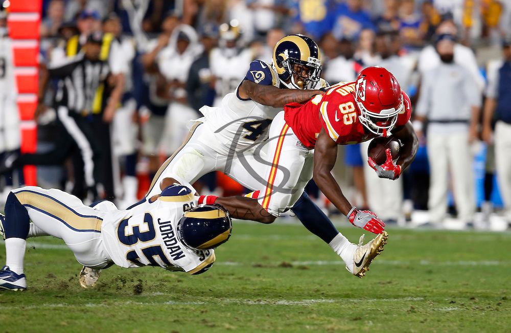 Kansas City Chiefs wide receiver Frankie Hammond, right, is tackled by Los Angeles Rams defensive back Michael Jordan, left, and cornerback Marcus Roberson during the second half of a preseason NFL football game, Saturday, Aug. 20, 2016, in Los Angeles. (AP Photo/Rick Scuteri)