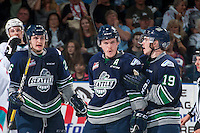KELOWNA, CANADA - APRIL 22: Donovan Neuls #19 and Scott Eansor #8 of the Seattle Thunderbirds celebrate a goal against the Kelowna Rockets on April 22, 2016 at Prospera Place in Kelowna, British Columbia, Canada.  (Photo by Marissa Baecker/Shoot the Breeze)  *** Local Caption *** Donovan Neuls; Scott Eansor;