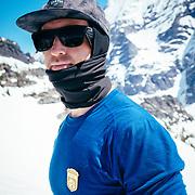 Griffin Post eating Shot Blocks while wearing his junior ranger badge in Glacier National Park.