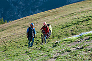 Paragliding from the summit of Elfer mountain down to Neustift im Stubaital, Tyrol, Austria. unfolding the parachute