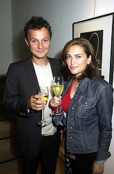 MISS SHEBAH RONAY daughter of designer Edina Ronay and MR JOHNNY YEO, at an exhibition in London on 19th September 2000.OHB 32